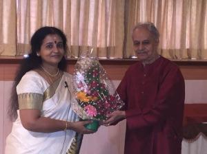 Justice Somasekhara Banavar presenting a bouquet.. — with Somasekhara Banavar.